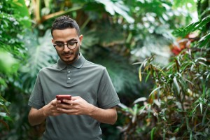shallow-focus-photo-of-man-using-a-smartphone-3228772